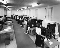 "Women and men working in the tabulating department in Administrative Annex building.<br /> Date: 1953<br /> Stamped verso ""Credit Photo CF&I Blast Pueblo, Colo.""<br /> Numbered CFI_ADM_0032<br /> Prints Admin Pueblo Box 8"