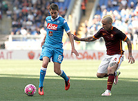 Calcio, Serie A: Roma vs Napoli. Roma, stadio Olimpico, 25 aprile 2016.<br /> Napoli&rsquo;s Jorginho, left, is chased by Roma&rsquo;s Radja Nainggolan during the Italian Serie A football match between Roma and Napoli at Rome's Olympic stadium, 25 April 2016. <br /> UPDATE IMAGES PRESS/Isabella Bonotto