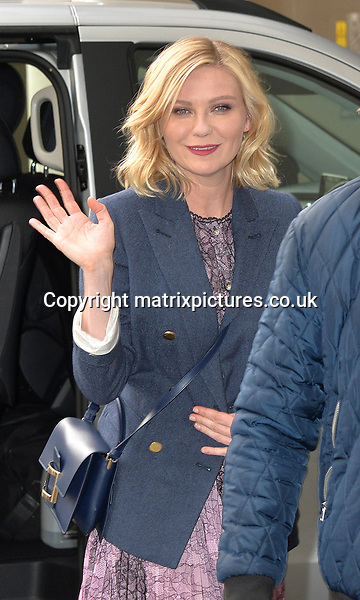 NON EXCLUSIVE PICTURE: MATRIXPICTURES.CO.UK<br /> PLEASE CREDIT ALL USES<br /> <br /> WORLD RIGHTS <br /> <br /> American actress Kirsten Dunst visits BBC Radio Studios, in London.<br /> <br /> The 33-year-old looks chic in a a girly lilac knee-length frock covered with a classy blue blazer style jacket.<br /> <br /> MARCH 31st 2016<br /> <br /> REF: JWN 16859