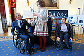 United States President Barack Obama tries an attachable lever that can make wheelchair movements easier and less tiring that was created by Kaitlin Rees (C) from Dover, Massachusetts, while Mohammed Sayed (R) from Cambridge Massachusetts who developed a 3D-printed modular arm looks up, at the White House, in Washington, DC, on March 23, 2015. The 2015 White House Science Fair is a celebration of students winners of STEM (Science, technology, engineering and math) competitions from across the country.<br /> Credit: Aude Guerrucci / Pool via CNP