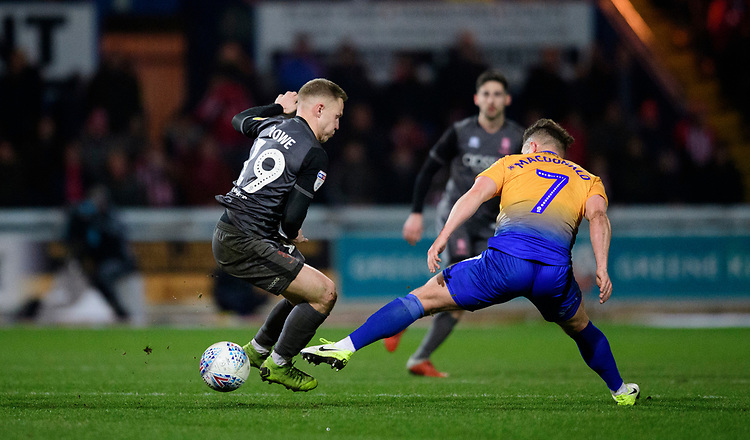 Lincoln City's Danny Rowe vies for possession with Mansfield Town's Alex MacDonald<br /> <br /> Photographer Chris Vaughan/CameraSport<br /> <br /> The EFL Sky Bet League Two - Mansfield Town v Lincoln City - Monday 18th March 2019 - Field Mill - Mansfield<br /> <br /> World Copyright © 2019 CameraSport. All rights reserved. 43 Linden Ave. Countesthorpe. Leicester. England. LE8 5PG - Tel: +44 (0) 116 277 4147 - admin@camerasport.com - www.camerasport.com