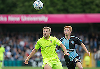 Nicky Featherstone of Hartlepool United & Ryan Sellers of Wycombe Wanderers keep eyes on the ball during the Sky Bet League 2 match between Wycombe Wanderers and Hartlepool United at Adams Park, High Wycombe, England on 5 September 2015. Photo by Andy Rowland.