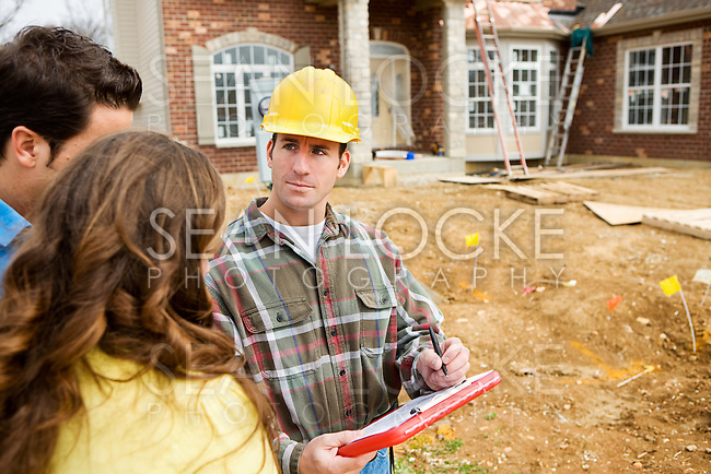 Series at a new home construction site.  Includes construction worker/builder, real estate agents and young Caucasian couple