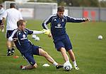Barry Bannan tackles David Goodwillie at Scotland training