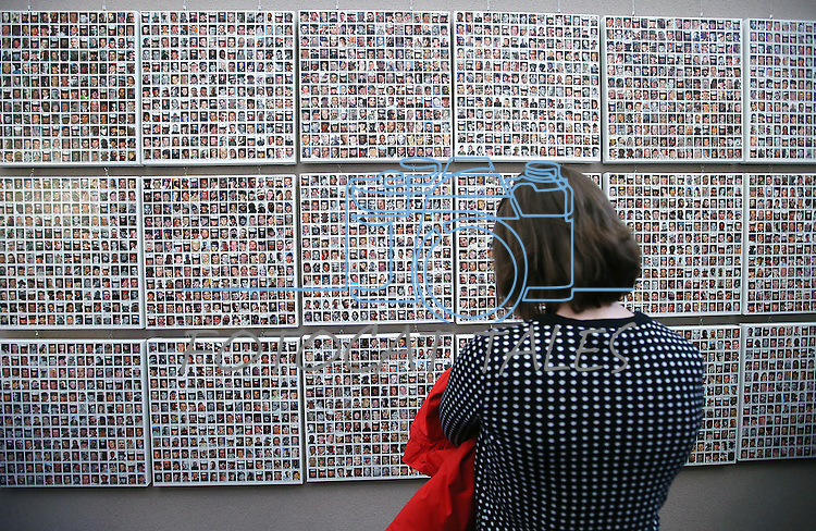 A visitor looks at the Wall of the Dead in the Always Lost: A Meditation on War exhibit at the Legislative Building in Carson City, Nev., on Monday, April 6, 2015. <br /> Photo by Cathleen Allison/Nevada Photo Source