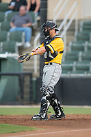 West Virginia Power catcher Taylor Gushue (17) gives defensive signs to his infield during the game against the Kannapolis Intimidators at Intimidators Stadium on July 2, 2015 in Kannapolis, North Carolina.  The Power defeated the Intimidators 5-1.  (Brian Westerholt/Four Seam Images)