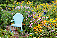 63821-205.15  Garden path with  blue chair and birdhouses.   Black-eyed Susans (Rudbeckia hirta), Purple Coneflowers (Echinacea purpurea), Gray-headed Coneflowers (Ratibida pinnata) and Pink Bee balm (Monarda fistulosa), Marion Co. IL