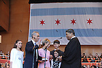 Chicago Mayor Rahm Emanuel is sworn in by Chief Judge of the Circuit Court of Cook County Timothy Evans as his family stands with him in Millennium Park in Chicago, Illinois on May 16, 2011.