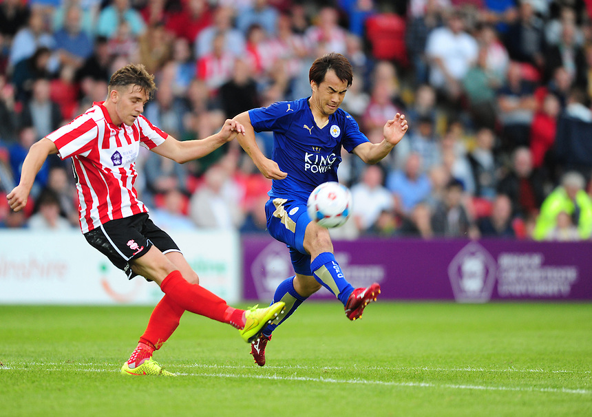 Leicester City&rsquo;s Shinji Okazaki is tackled by Lincoln City&rsquo;s Callum Howe<br /> <br /> Photographer Chris Vaughan/CameraSport<br /> <br /> Football - Football Friendly - Lincoln City v Leicester City - Tuesday 21st July 2015 - Sincil Bank - Lincoln<br /> <br /> &copy; CameraSport - 43 Linden Ave. Countesthorpe. Leicester. England. LE8 5PG - Tel: +44 (0) 116 277 4147 - admin@camerasport.com - www.camerasport.com