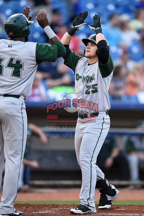 Fort Wayne TinCaps designated hitter Jake Bauers (25) greeted at home by Franmil Reyes (34) after hitting a home run during a game against the Lake County Captains on August 21, 2014 at Classic Park in Eastlake, Ohio.  Lake County defeated Fort Wayne 7-8.  (Mike Janes/Four Seam Images)