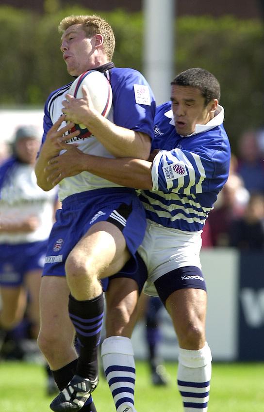 Photo. Richard Lane. .Sale v Bath. 19/8/2000. Zurich Premiership..Mike Tindall takes a high ball as Vaughan Going challenges.