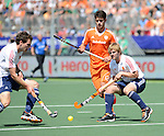 The Hague, Netherlands, June 13: During the field hockey semi-final match (Men) between The Netherlands and England on June 13, 2014 during the World Cup 2014 at Kyocera Stadium in The Hague, Netherlands. Final score 1-0 (1-0)  (Photo by Dirk Markgraf / www.265-images.com) *** Local caption *** (R-L) Ashley Jackson #7 of England, Robbert Kemperman #12 of The Netherlands