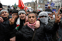 Stop the massacre in Gaza demonstration..March and rally.Organised by Stop the War Coalition, Muslim Association of Britain, Palestinian Solidarity Group..Victoria Square.Birmingham.17.1.09..Young men protesting against the massacre in Gaza