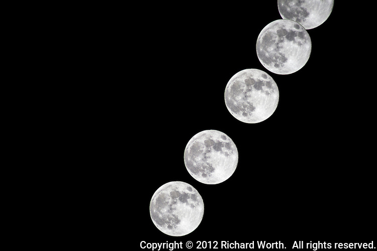 A series of images taken minutes apart then merged track the progress of the full Hunter's Moon.