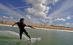 27 September 2007, Hossegor --- An unidentified surfer practices on a warm-up session during the Quiksilver Pro France, which is a part of the Foster's ASP World Tour of Surfing, at Hossegor in the south west coast of France. Photo by Victor Fraile --- Image by © Victor Fraile/Corbis