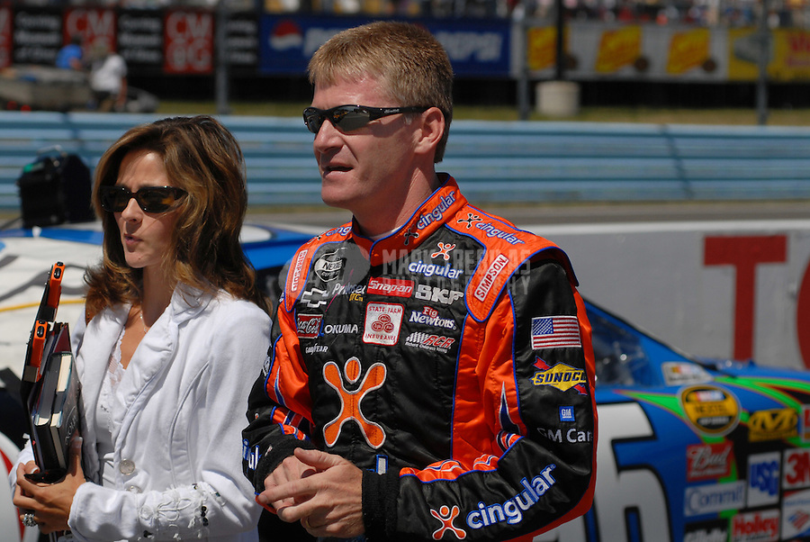 Aug. 12, 2006; Watkins Glen, NY, USA; Nascar Nextel Cup driver Jeff Burton (31) and his wife Kim during practice for the AMD at the Glen at Watkins Glen International. Mandatory Credit: Mark J. Rebilas