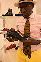 Ndjoko Defustel, creator of a capsule for the Spring Summer 2017 collection of Roberto Botticelli's shoe brand, shows his favorite shoe, Milan June 19, 2016. © Carlo Cerchioli