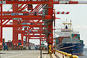 May 23, Tokyo, Japan - Men work in a shipping container port loading cargo containers onto a ship. According to the Ministry of Finance Japan report, the country acquired a trade balance of 520.27 billion yen in April, compared with 470.8 billion yen in the previous year. Exports increased 7.9 percent from a year earlier which was below the expected 11.8 increase economists had hoped for. Imports, on the other hand, saw a 8.0 percent increase to 6.087 trillion yen. (Photo by: Christopher Jue/AFLO)