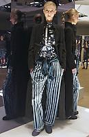 Model in Look 1: Black Melton Coat, Fall Leaves Top, Teal Velvet Top, Suiting Stripe Pants