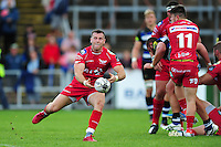 Gareth Davies of the Scarlets passes the ball. Pre-season friendly match, between the Scarlets and Bath Rugby on August 20, 2016 at Eirias Park in Colwyn Bay, Wales. Photo by: Patrick Khachfe / Onside Images