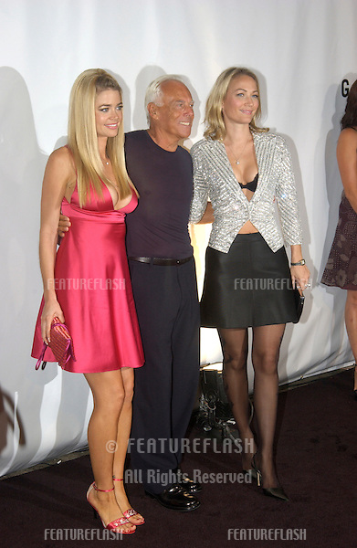 Actresses DENISE RICHARDS (left) & SARAH WYNTER with designer GIORGIO ARMANI at fashion show event on Rodeo Drive, Beverly Hills, where designer Giorgio Armani was honored with the first Rodeo Drive Walk of Style Award..Sept 9, 2003