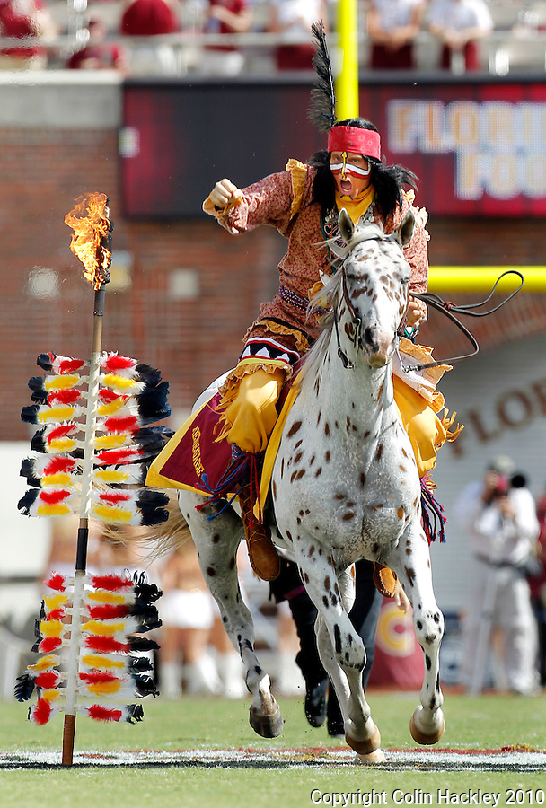 TALLAHASSEE, FL 9/25/10-FSU-WF FB10 CH-Florida State Mascot Chief Osceola portrayed by Drake Anderson rides Renegade off the field prior to the Wake Forest game Saturday at Doak Campbell Stadium in Tallahassee. .COLIN HACKLEY PHOTO