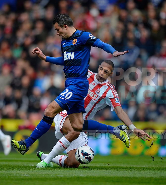 Robin van Persie of Manchester United tackled by Steven N'Zonzi of Stoke City - Barclays Premier League - Stoke City vs Manchester Utd - Britannia Stadium - Stoke - England - 14/04/13 - Picture Simon Bellis/Sportimage