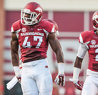 STAFF PHOTO ANTHONY REYES &bull; @NWATONYR<br /> Arkansas linebacker Martrell Spaight (47) celebrates a defensive stop against Northern Illinois University in the first quarter Saturday, Sept. 20, 2014 at Razorback Stadium in Fayetteville.