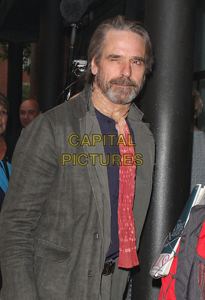 JEREMY IRONS .Press Night for Northern Ballet's 'Cleopatra' at Sadlers Wells, London, England, UK, May 17th 2011..half length grey gray  red beige scarf beard facial hair  jacket winking eye funny .CAP/ROS.©Steve Ross/Capital Pictures