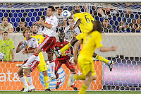 New York Red Bulls goalkeeper Bouna Coundoul (18) watches as Andy Iro (6) of the Columbus Crew heads the ball in for the second goal of the game during a Major League Soccer (MLS) match at Red Bull Arena in Harrison, NJ, on May 20, 2010.