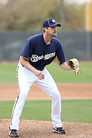 Sean Green #54 of the Milwaukee Brewers participates in pitchers fielding practice during spring training workouts at the Brewers complex on February 18, 2011  in Phoenix, Arizona. .Photo by Bill Mitchell / Four Seam Images.