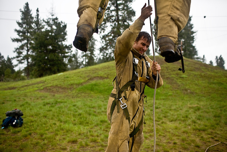 Smokejumper practice their technique on the 'let-down simulator' at the smokejumper base in McCall, ID in wet conditions.