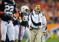 Jan 10, 2011; Glendale, AZ, USA; Auburn Tigers head coach Gene Chizik reacts during the 2011 BCS National Championship game against the Oregon Ducks at University of Phoenix Stadium. The Tigers defeated the Ducks 22-19. Mandatory Credit: Mark J. Rebilas-