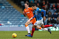 Blackpool's Ben Heneghan competing with Portsmouth's Gareth Evans<br /> <br /> Photographer Andrew Kearns/CameraSport<br /> <br /> The EFL Sky Bet League One - Portsmouth v Blackpool - Saturday 12th January 2019 - Fratton Park - Portsmouth<br /> <br /> World Copyright &copy; 2019 CameraSport. All rights reserved. 43 Linden Ave. Countesthorpe. Leicester. England. LE8 5PG - Tel: +44 (0) 116 277 4147 - admin@camerasport.com - www.camerasport.com