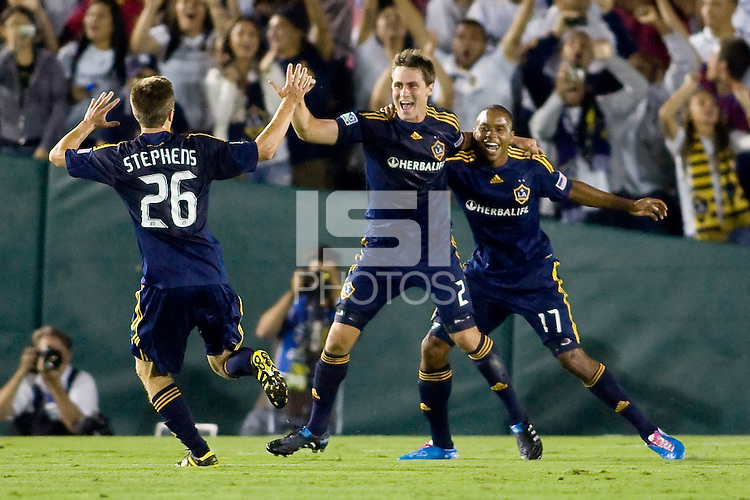 Todd Dunivant of the LA Galaxy celebrates his goal with teammates Michael Stephens and Tristan Bowen (17). Real Madrid beat the LA Galaxy 3-2 in an international friendly match at the Rose Bowl in Pasadena, California on Saturday evening August 7, 2010.