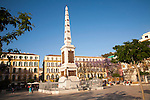 People enjoying a sunny spring afternoon in Plaza de la Merced, Malaga Spain