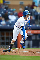 Jake Cronenworth (1) of the Durham Bulls starts down the first base line against the Gwinnett Braves at Durham Bulls Athletic Park on April 20, 2019 in Durham, North Carolina. The Bulls defeated the Braves 11-3 in game one of a double-header. (Brian Westerholt/Four Seam Images)