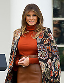 """First Lady Melania Trump looks on as she and United States President Donald J. Trump host the National Thanksgiving Turkey Pardoning Ceremony in the Rose Garden of the White House in Washington, DC on Monday, November 20, 2017.  According to the White House Historical Association, the ceremony originated in 1863 when US President Abraham Lincoln's granted clemency to a turkey. The tradition jelled in 1989 when US President George HW Bush stated """"But let me assure you, and this fine tom turkey, that he will not end up on anyone's dinner table, not this guy -- he's granted a Presidential pardon as of right now -- and allow him to live out his days on a children's farm not far from here.""""<br /> Credit: Ron Sachs / CNP"""
