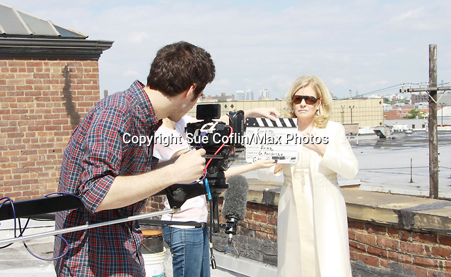 Gianluca Randazzo (Director of Photography) and Tina Sloan who stars in Empire The Series as it films on set June 3, 2012 in Brooklyn, New York. (Photo by Sue Coflin/Max Photos)