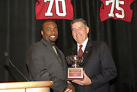 14 January 2007: Bob Bowlsby presents an award to Michael Okwo at the annual football banquet at McCaw Hall in Stanford, CA.
