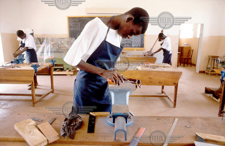 © Chris Sattlberger / Panos Pictures..Banjul, GAMBIA..Woodwork training for boys in the SOS Childrens' Village.