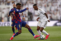 1st March 2020; Estadio Santiago Bernabeu, Madrid, Spain; La Liga Football, Real Madrid versus Club de Futbol Barcelona; Vinicius Junior (Real Madrid) is tackled by Nélson Semedo of Barca
