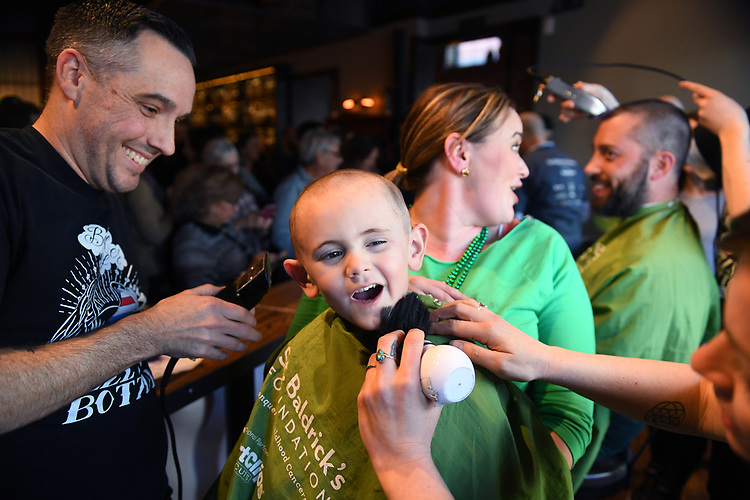 UNITED STATES - MARCH 12: Carter Furey, 4, of Germantown, Md., who is in remission from Retinoblastoma, gets his head shaved during a St. Baldrick's event at Boundary Stone pub to raise money to fight childhood cancer, March 12, 2017. Retinoblastoma is cancer that effects the eye. (Photo By Tom Williams/CQ Roll Call)