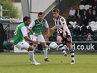 Paul McGowan (right) passing watched by Thomas Soares (left) and George Francomb in the St Mirren v Hibernian Clydesdale Bank Scottish Premier League match played at St Mirren Park, Paisley on 29.4.12.
