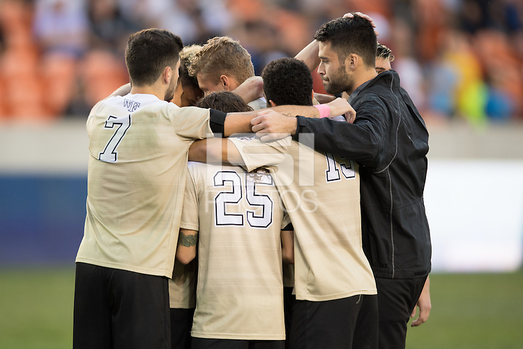 Houston, TX -  Sunday, December 11, 2016: The Wake Forest Demon Deacons huddle after losing the NCAA Division 1 Soccer Championship to the Stanford Cardinal at the  NCAA Men's Soccer Finals at BBVA Compass Stadium.