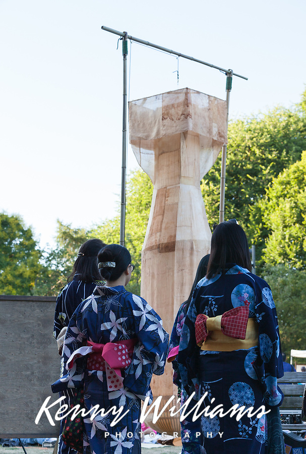 "Asian women performers dressed in beautiful blue kimonos and ""Little Boy, Folded"" atomic bomb sculpture. From Hiroshima to Hope 2015, Seattle, Washington State, WA."