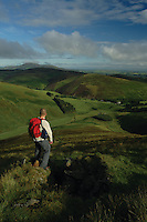 A hillwalker on the slopes of Fell Shin and Culter Fell looking towards Tinto Hill and the Clyde Valley above the village of Coulter, South Lanarkshire<br /> <br /> Copyright www.scottishhorizons.co.uk/Keith Fergus 2011 All Rights Reserved