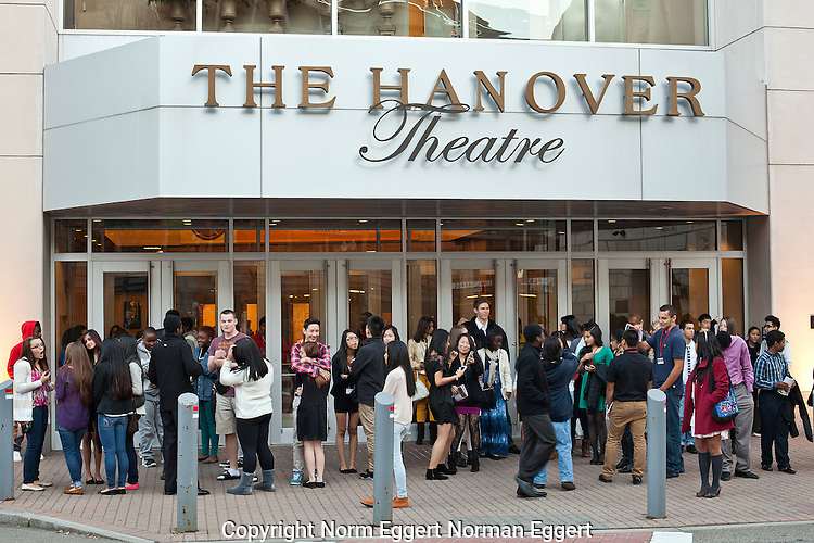 People standing outside the Hanover Theater in Worcester, MA