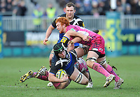 Mat Gilbert is double-tackled to ground. LV= Cup match, between Bath Rugby and Exeter Chiefs on January 26, 2013 at the Recreation Ground in Bath, England. Photo by: Patrick Khachfe / Onside Images