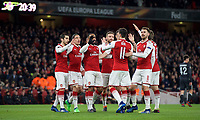 Teammates celebrates with goal scorer Alexandre Lacazette of Arsenal during the UEFA Europa League QF 1st leg match between Arsenal and CSKA Moscow  at the Emirates Stadium, London, England on 5 April 2018. Photo by Andrew Aleksiejczuk / PRiME Media Images.